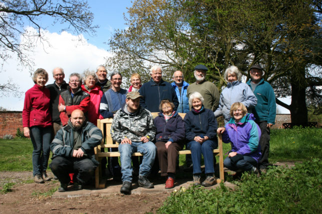 Volunteers congregate around the new commemorative benches dedicated to Owen's Mum Paula