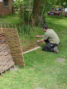Laurence - resident willow weaver.