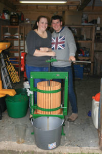 Cath and Ryan pressing cider apples